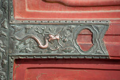 Dragon detail at the Forbidden City, Beijing, China. BEIJING, CHINA - Dragon detail on a door within the Forbidden City, Beijing. The dragon is a common symbol stock photos