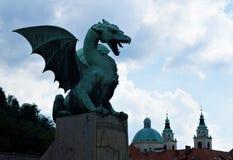 Dragon from the dragon bridge and St. Nicholas cathedaral Ljubljana Royalty Free Stock Images