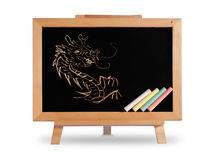 Dragon drawing Blackboard wood frame. Placed on the white desk with shadow royalty free stock photos