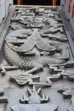 Dragon embossment on the steps to a buddha's hall Stock Photo