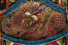 Dragon Embroidery. Embroidery of oriental Asian dragon Royalty Free Stock Photo