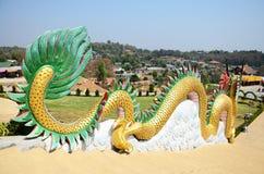 Dragon at entrance of Chedi of Wat Huay Pla Kang Temple in Chiangrai, Thailand. Stock Photos