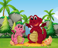 Dragon family. Dragons coming out of the egg shell Royalty Free Stock Photo