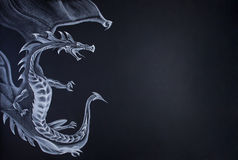 The dragon. Farytale dragon draw with chalk on paper. Large copy space on right royalty free stock images