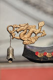 Dragon figure with bell as decoration of Taoist temple, Beijing, China Royalty Free Stock Photography