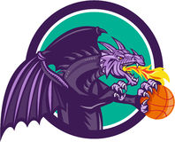 Dragon Fire Holding Basketball Circle Retro. Illustration of a purple dragon breathing fire clutching holding an orange basketball viewed from the side set Royalty Free Stock Image