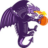 Dragon Fire Holding Basketball Isolated Retro. Illustration of a purple dragon breathing fire clutching holding an orange basketball viewed from the side set on Royalty Free Stock Image