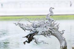 Dragon fish are animals in Thai novel, in public park Stock Photo