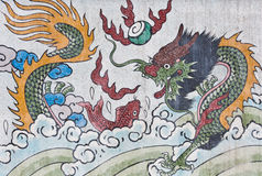 Dragon  and fish painting on mable wall Stock Image