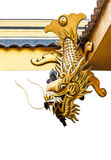 Dragon Fish  Statue. Golden Dragon fish statue on the roof of Chinese temple Stock Photo
