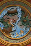 A dragon and a fish were sculptured on one of the walls of a Buddhist temple in Hoi An (Vietnam) Royalty Free Stock Photo