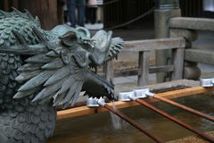 Dragon fountain of Japanese Tsukubai at an old temple Royalty Free Stock Photo