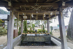 Dragon fountain in Shirahige Shrine Royalty Free Stock Photography