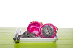 Dragon fruit is being made into balls on a white plate. Royalty Free Stock Photography