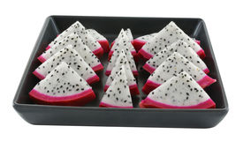 Dragon fruit in a black dish Royalty Free Stock Images