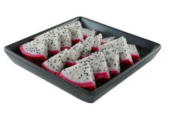 Dragon fruit in a black dish Royalty Free Stock Image