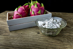 Dragon Fruit in the bowl on the wooden table, Selective focus. Royalty Free Stock Photos