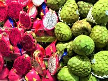 Dragon fruit, cherimoya and colours in Boqueria Market, Barcelona, Spain. Food, nourishment, healthy lifestyle and beautiful details in a touristic location stock photos