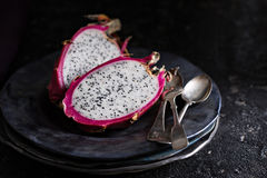 Dragon fruit cut open on a plate Stock Images