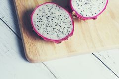 Dragon fruit. On wooden cutting board Royalty Free Stock Photos