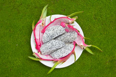 Dragon Fruit on green background. Royalty Free Stock Photography