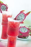 Dragon fruit juice. Display of exotic juices extracted from dragon fruit Royalty Free Stock Photo