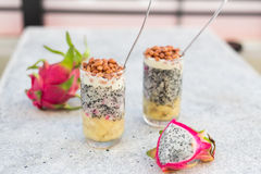 Dragon fruit juice smoothies with nuts and banana cocktail Stock Photos