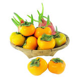 Dragon fruit and persimmon in the Basket. Royalty Free Stock Photo