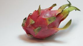 Dragon fruit Pitaya on a white background. The camera zooms in and turns slightly stock footage