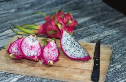Dragon fruit is placed on a wooden board.  Stock Photo