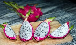Dragon fruit placed on wooden planks.  Stock Photos