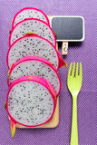 Dragon fruit and price tag on tablecloth Stock Photo
