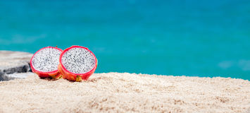 Dragon Fruit On Sand Stock Photo