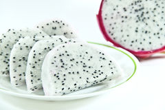 Dragon fruit slice in dish on white background Royalty Free Stock Photos