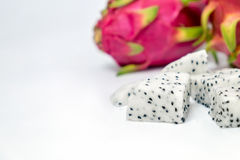 Dragon fruit slice on white background Stock Images