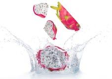 Dragon fruit in water splash isolated Stock Photos