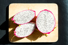 Dragon fruit on wooden chopping board Stock Photography