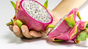 Dragon fruits. Hand holding a slices of bright juicy tropical dragon fruit stock photo
