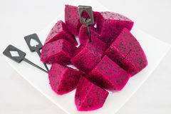Dragon fruits and  slice on plate Stock Photos