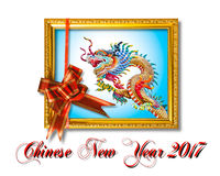Dragon in the gloden frame with red silky bow, Chainese new year Royalty Free Stock Photos