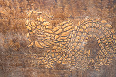 Dragon. Gloden dragon on the wall Stock Photography
