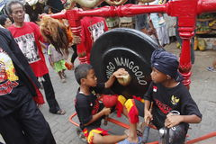 Dragon gong. Children play gong, a percusion from cooper on reog art traditional in Java Royalty Free Stock Photo