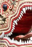 Dragon guard statue close up in the buddhist temple Royalty Free Stock Photography