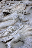 Dragon head. The head of the dragon of rock carvings Royalty Free Stock Photos