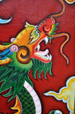 Dragon head. Colorful dragon painted on a door in Vietnam Royalty Free Stock Photo