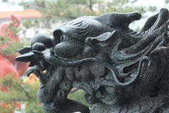 Dragon Head Black Stone Sculpture Fotografering för Bildbyråer