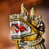 Dragon head closeup. Dragon head. Oriental dragon head closeup. Traditional golden Chinese and Japanese dragon Stock Images