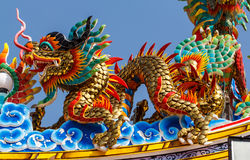 Dragon head sculpture on wall of temple. In Thailand Stock Images