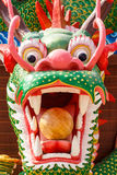 Dragon head sculpture on wall of temple. In Thailand Royalty Free Stock Photography