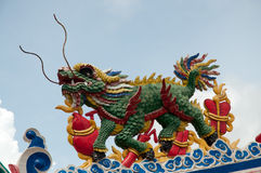 Dragon-headed unicorn. Dragon sculpture on the shrine or temple Stock Photo